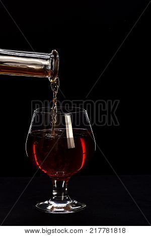 Bottle Of Wine Near Glass On Black Background