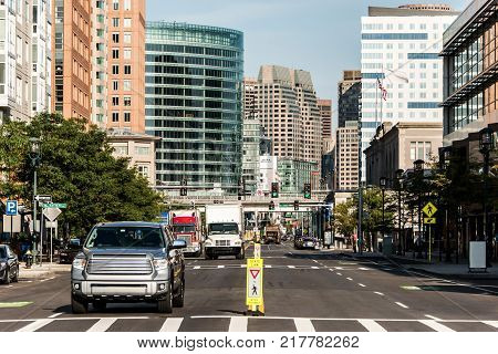 Boston MA USA skyline in summer day, panoramic view on buildings in downtown and road Street with traffic at waterfront side