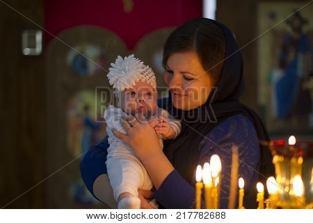 Belarus the city of Gomel on October 25 2017. Church of the farm. The baptism of a child.The mother holds the child on her hands during the rite of baptism.Accept religion