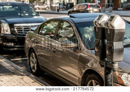 Boston USA Massachusetts - Parking meter at paid parking in the street with cars behind it