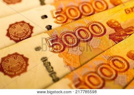 Russian money banknotes with biggest value (5000 rubles) close up. Macro shot of orange  banknotes. Finance concept.