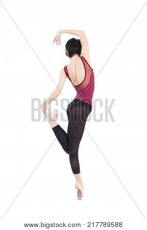 ballerina is dancing in the studio on a white background isolate.