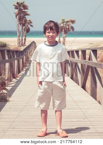 Typical family photo of a boy at the beach of Tarifa vintage look