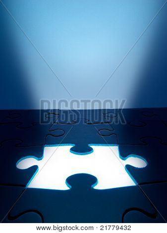 Light coming from the missing jigsaw puzzle: business / human resources concept