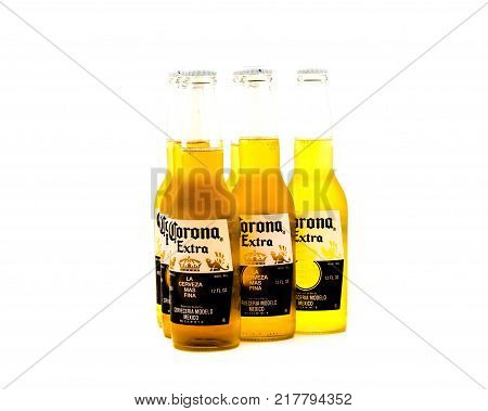 HUMBLE TX US-OCT 24 2017: Pack six bottle Corona Extra beer isolated on white. A pale lager produced by Grupo Modelo a large brewery in Mexico own by Belgian-Brazilian company Anheuser-Busch InBev