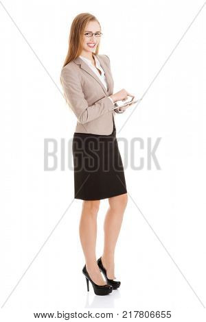 Beautiful business woman with tablet.