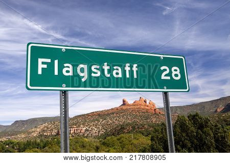 A sign with a scenic mountain background in Arizona