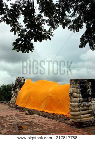 Reclining Buddha statue covered with an orange canvas, Thailand.