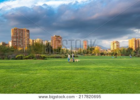 Santiago Region Metropolitana Chile - May 13 2017: View of Parque Juan Pablo II the extension of Parque Araucano forming the mayor urban public park in Las Condes district surrounded by apartment buildings.