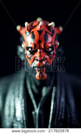 Macro portrait of Star Wars Phantom Menace Sith Lord Darth Maul using Hasbro Black Series action figure. Darth Maul was played by actor Ray Park