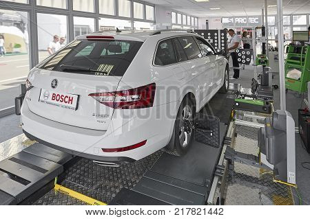 MOSCOW, AUG. 22, 2017: Exhibition stand car maintenance and diagnostic equipment devices tools. Wheel alignment equipment. Car maintenance repair diagnostic stand equipment. Car MOT repair works