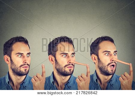 Man with long nose isolated on grey wall background. Liar concept. Human face expressions emotions feelings.