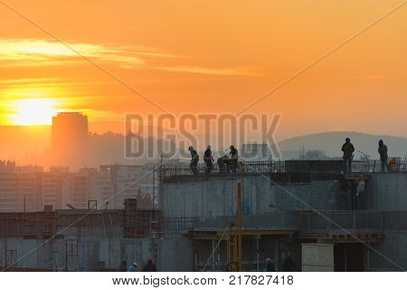 Santiago Las Condes district Chile - August 08 2017: Workers on a real estate development in Las Condes district one of the wealthiest and booming areas for construction of the city.