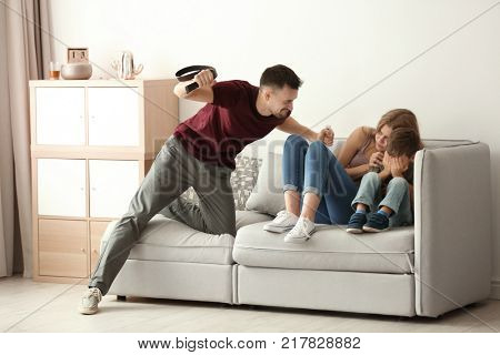 Man threatening his son and wife at home