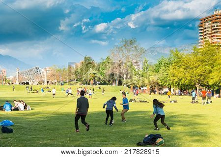 Santiago Region Metropolitana Chile - October 01 2017: People gather and practice sports on the weekend at Parque Araucano the mayor urban park in Las Condes district.