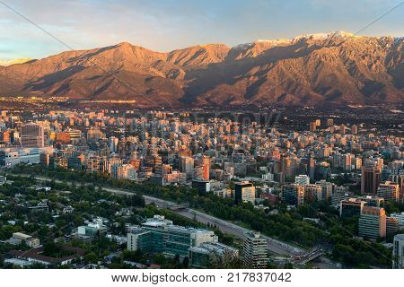 Santiago Region Metropolitana Chile - December 26 2016: View of buildings at Providencia district the most dense part of the city with residential and office buildings and Los Andes mountain range as background.