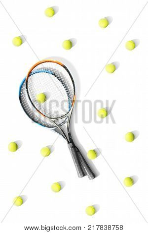 Tennis. Tennis rackets and balls the white background. Isolated. Sport