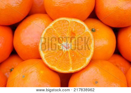 Fresh Orange on the market, Orange is the sacred wood that are important and meaningful, especially for the Chinese New Year festival. This image focus at sliced orange