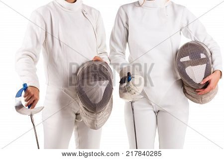 Torso of two young fencers, dressed in a fencing uniform, and holding a mask for fencing. Isolated on white background.