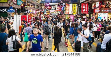 HONG KONG, CHINA - APR 3, 2016: Unidentified tourists walk by the street in Hong Kong on Apr 3, 2016, China.