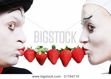 Couple of mimes with the strawberry on a white background