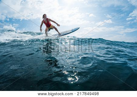 Surfer rides the ocean wave. Extreme sport and active lifestyle concept.