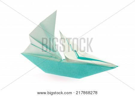 Sailing vessel of origami, isolated on white background.