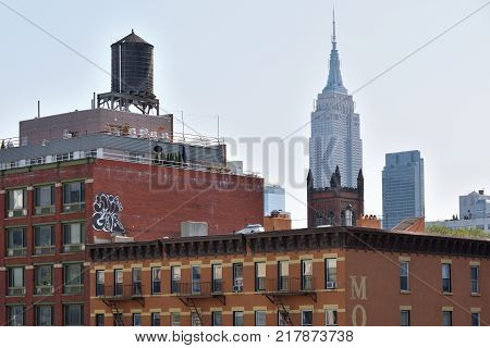 NEW YORK CITY USA - AUG. 26: Empire State Building in Manhattan on August 26 2017 in New York City NY. Empire State Building is a Art Deco skyscraper in Midtown Manhattan New York City