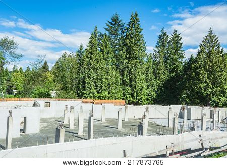 Concrete basement structure of new low-rise building on sunny day in British Columbia, Canada