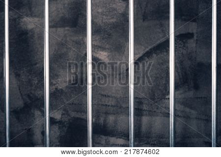 Jail bars empty dark prison cell as conceptual background for crime and punishment