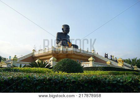 HUA HIN THAILAND - 9 DEC 2017: Statues of Buddhist Monk at Wat Huay Mongkol Buddhist Temple in Thailand