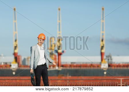 Handsome Young Unshaven Successful Business Man In Suit And Protective Construction Orange Helmet, H
