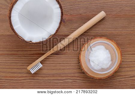 coconut oil toothpaste, natural alternative for healthy teeth, wooden toothbrush, dental equipment, flat