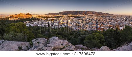View of Acropolis and Athens from Filopappou hill at sunset, Greece.