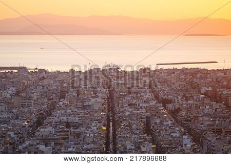 View of Athens from Filopappou hill towards Aegina island and Peloponnese at sunset, Greece.