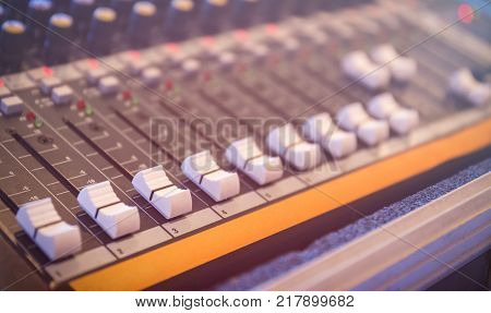 Sound mixer control panel, closeup of audio faders