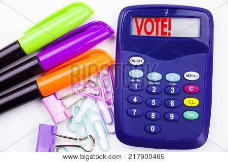 Writing word Vote text in the office with surroundings marker, pen writing on calculator. Business concept for Voting Electoral Vote white background with space