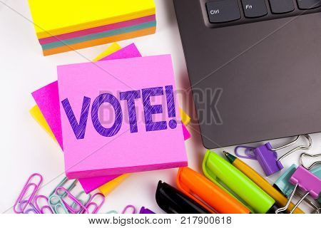 Writing text showing Vote made in the office with surroundings such as laptop, marker, pen. Business concept for Voting Electoral Vote Workshop white background space