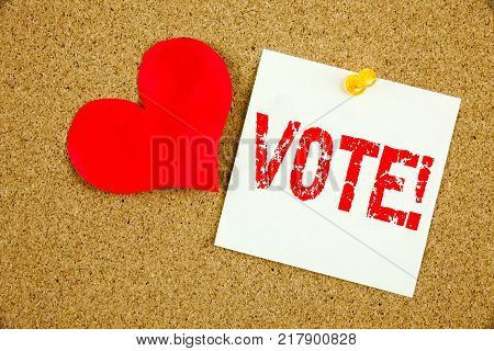 Conceptual hand writing text caption inspiration showing Vote concept for Voting Electoral Vote and Love written on sticky note, reminder cork background with space