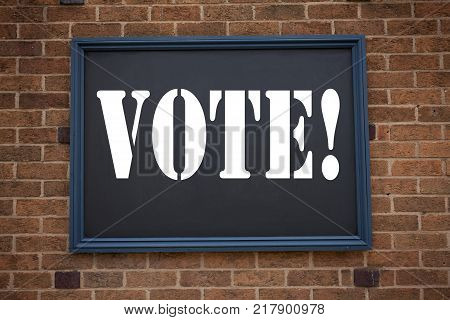 Conceptual hand writing text caption showing announcement Vote. Business concept for  Voting Electoral Vote written on frame old brick background with space