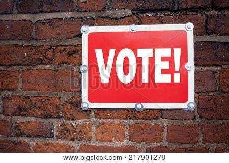 Hand writing text caption inspiration showing Vote concept meaning Voting Electoral Vote written on old announcement road sign with background and space