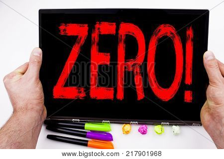Zero text written on tablet, computer in the office with marker, pen, stationery. Business concept for Zero Zeros Nought Tolerance white background with space