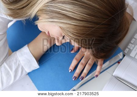 Tired businesswoman at workspace in office take nap. Sleepy white collar idle lazy student study with headache secretary career frustration employment problem paperwork freelance concept