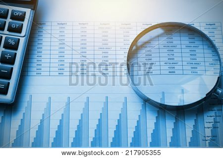 business documents accounting with calculator and magnifying glass. concept for financial