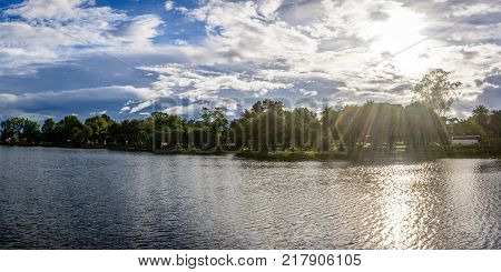 landscape photo of Naung Yar Lake with cloudy and sunshine background, Loikaw, Kayah State, Myanmar, Oct-2017