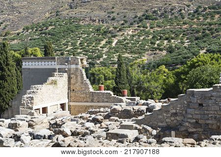 Knossos palace at Crete Greece Knossos Palace is the largest Bronze Age archaeological site on Crete and the ceremonial and political centre of the Minoan civilization and culture columns of the Palace of Knossos.