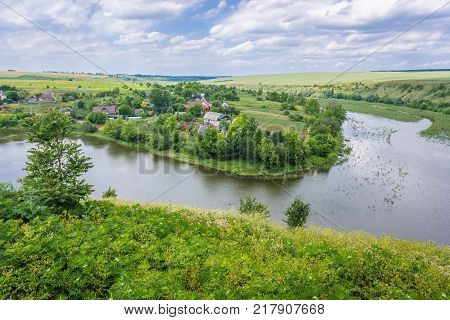 Aerial view of Zhvanchyk River tributary of the Dniester from castle ruins in Zhvanets town Ukraine