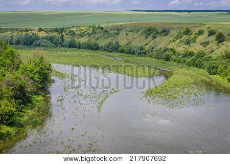 Aerial view of Zhvanchyk River tributary of the Dniester in Zhvanets village Ukraine
