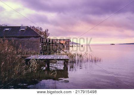 Old wooden boat houses at Lake Starnberg in Bavaria Germany