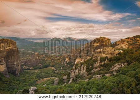 Landscape of monasteries of Meteora in Greece in Thessaly at the early morning. Cliffs of Meteora opposite a morning cloudy sky background